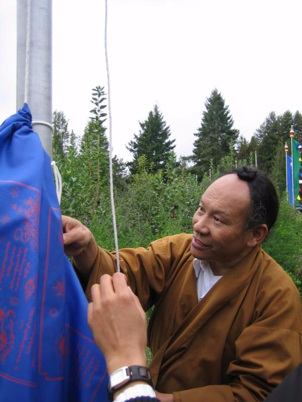 Rinpoche_Raising_Prayer_Flags.jpg